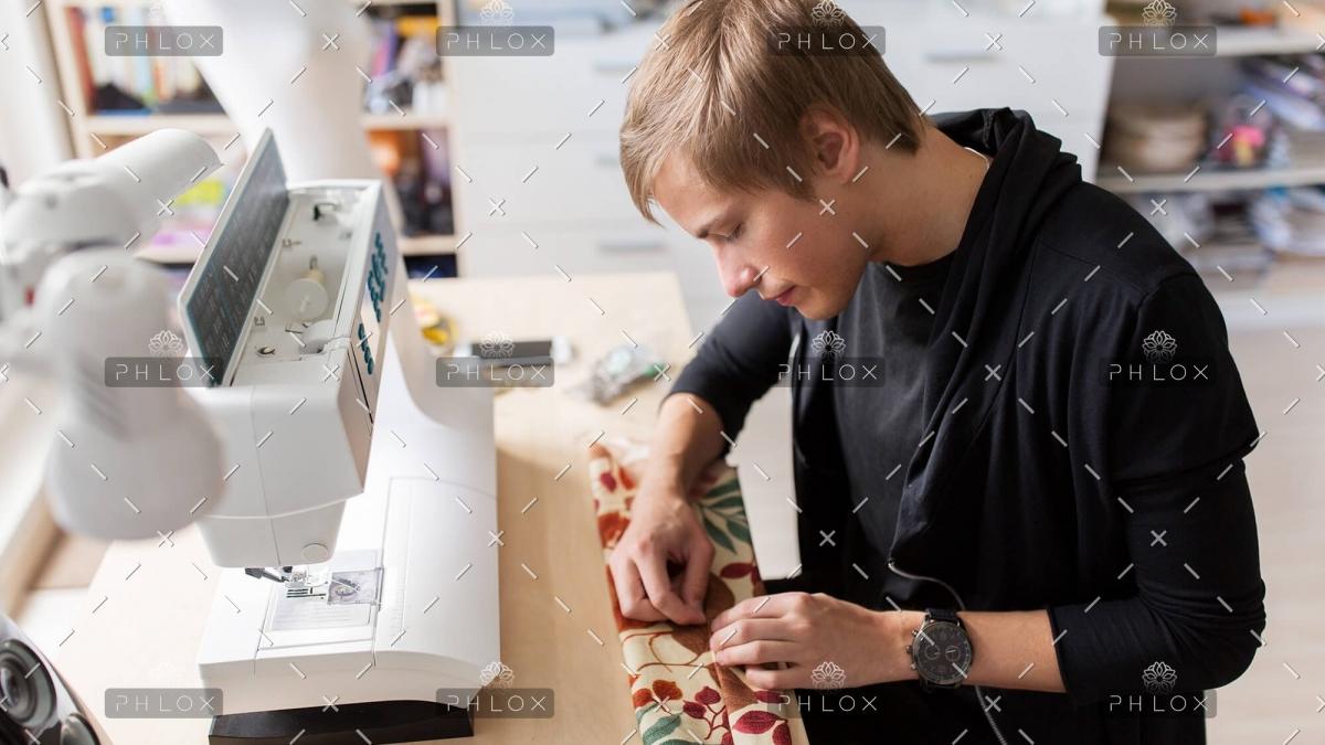 fashion-designer-with-making-dress-at-studio-P75Z6LP