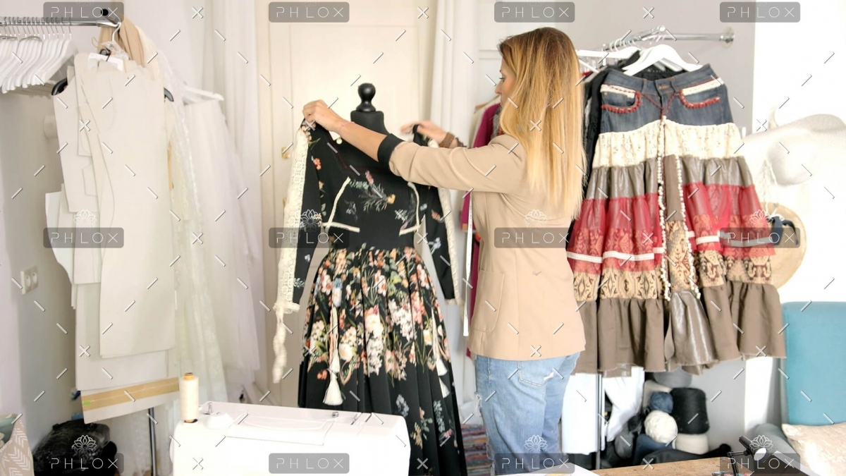 female-using-mannequin-for-sewing-PK382VN